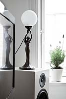 Sculptural lamp on speaker
