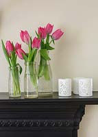 Bottles of Tulips on mantlepiece