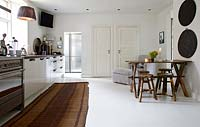 Painted floorboards in kitchen