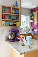 Colourful kitchen accessories on granite worktop