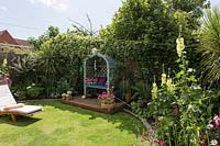 Back garden with arbour seat