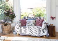 Patterned soft furnishings on sofa