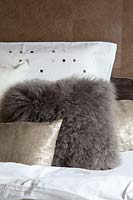 Fluffy cushions on bed