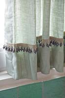 Green curtains in bathroom