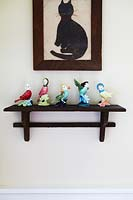 Bird ornaments on wooden shelf