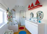 Modern bathroom with colourful toys and ornaments