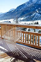 Wooden balcony with mountain view
