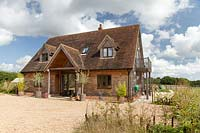 Country style house and gravel drive