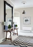 Patterned lamps on console table