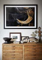 Eclectic ornaments and art on wooden chest
