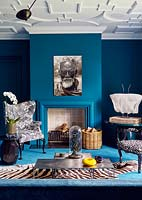 Eclectic furniture and accessories around fireplace