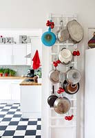 Pots hanging from rack