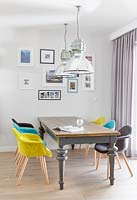 Open plan dining area with colourful chairs