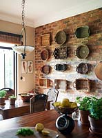 Display of baskets on kitchen wall