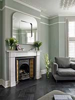 Modern mirror above period fireplace