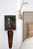 Portrait painting on wooden shelf