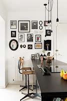 Photo display on kitchen wall