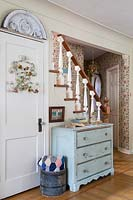 Blue chest of drawers by stairs