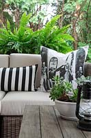 Patterned cushions on garden seat