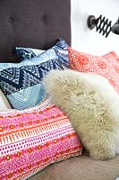 Patterned cushions on bed