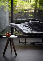Chaise longue by window