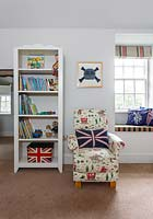 Patterned armchair in childs bedroom