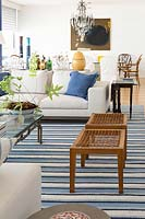 Wooden stools on striped rug