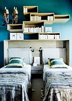 Storage above beds in childs room