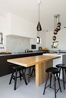 Contemporary kitchen with breakfast bar