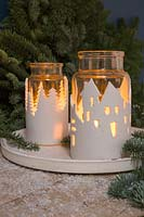 Clay Lanterns - glass jars wrapped with a textured clay cityscape