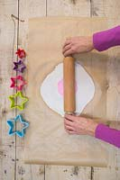 Making clay stars - Lay the silicone flower mould on top of the modelling clay, and gently use the rolling pin to add a light impression from the mould