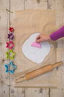 Making clay stars - Create multiple pattern impressions on the modelling clay using the silicone mould