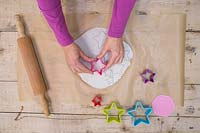 Making clay stars - Use the star shape cutters to create a variety of different sized stars