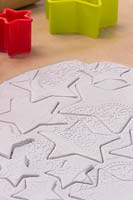 Making clay stars - a variety of different sized stars cut out from the modelling clay