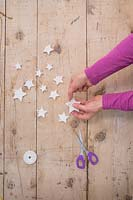 Making clay stars - Adding string to the stars so they can be hung