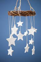 Homemade clay stars with a floral design
