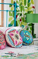 Colourful cushions on bed