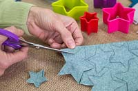 Making a felt christmas tree - Cut out the stars following the pencil guideline