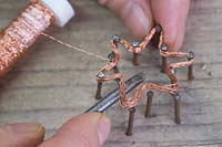 Making copper wire star decorations - Use a screwdriver or similar object to help remove the star from the nails