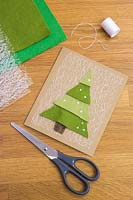 Making felt christmas tree cards - Materials required are a needle, thread, net fabric, coloured felt and a pair of scissors