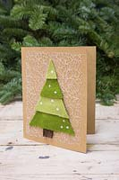 Making felt christmas tree cards - A hand made Christmas card featuring a layered Christmas tree against a white background