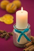 Candle in a glass jar with a felt ribbon, accompanied with Christmas themed items
