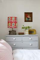 Patterned lamp on chest of drawers