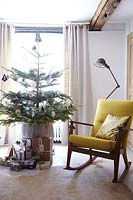 Rocking chair by christmas tree