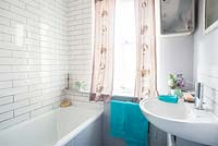 Patterned curtains in bathroom