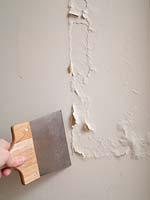 Removing paint from bathroom wall