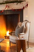 Armchair by fireplace