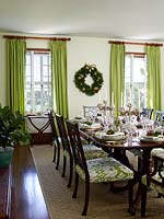 Dining table decorated for christmas meal