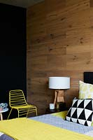 Wooden feature wall in bedroom