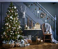 Christmas tree by staircase
